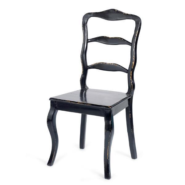 Flot antik stol i sort der passer til bordet i samme stil hos ...